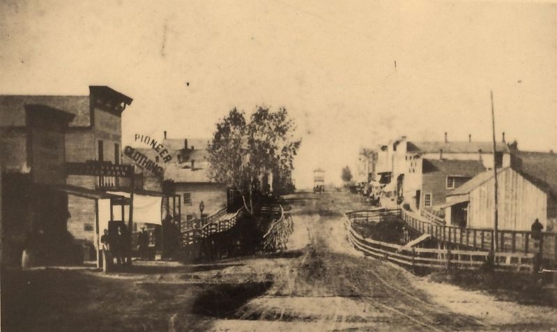 Marker detail: Phoenix Street looking west from Broadway in the late 1880s image. Click for full size.