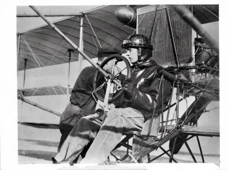 <i>Pilot Glen Martin at the controls of his aircraft as a mechanic prepares the plane...</i> image. Click for full size.
