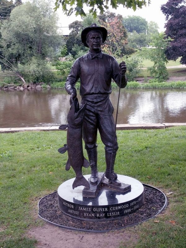 Statue of James Oliver Curwood image. Click for full size.