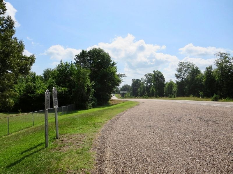 View looking east on Texas Highway 155 towards Avinger. image. Click for full size.