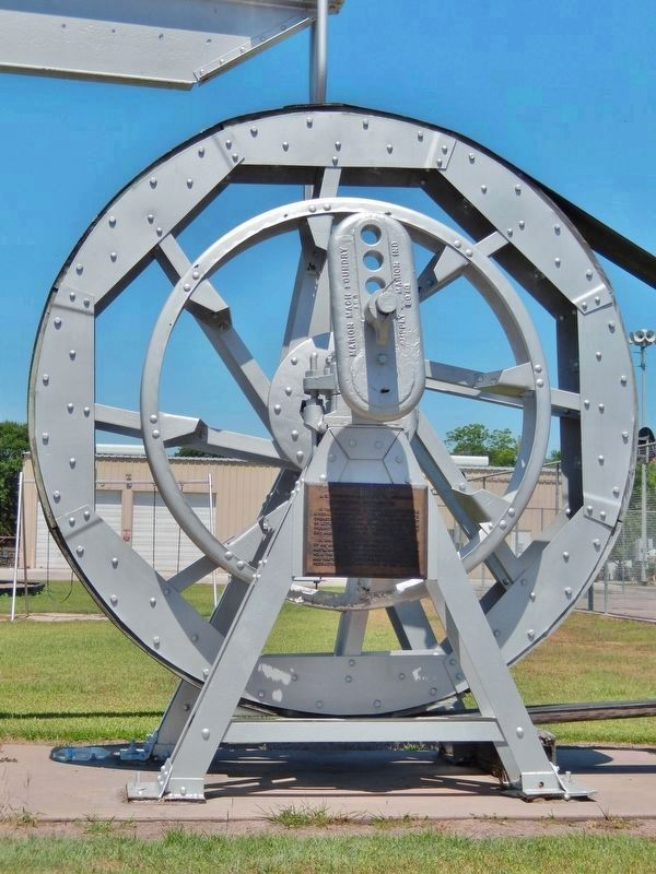 J.S. Abercrombie Mineral Company Marker (<i>tall view; marker is mounted on bandwheel support</i>) image. Click for full size.