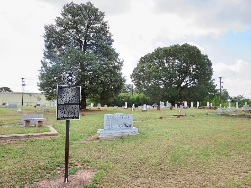 View of marker and graves in background. image. Click for full size.