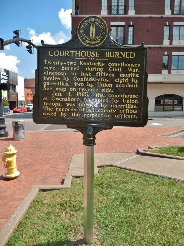 Courthouse Burned Marker (<i>side 1; tall view; looking east along West 2nd Street</i>) image. Click for full size.