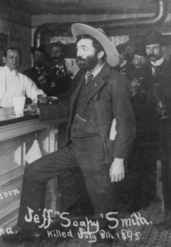 "Jefferson ""Soapy"" Smith standing at bar in saloon in Skagway, Alaska. July 1898 image. Click for full size."
