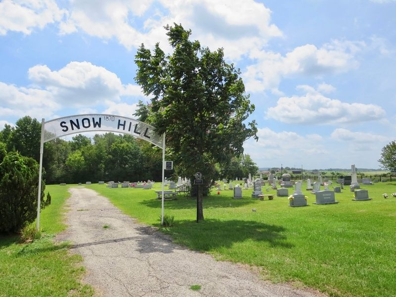 Snow Hill Cemetery next to church. image. Click for full size.