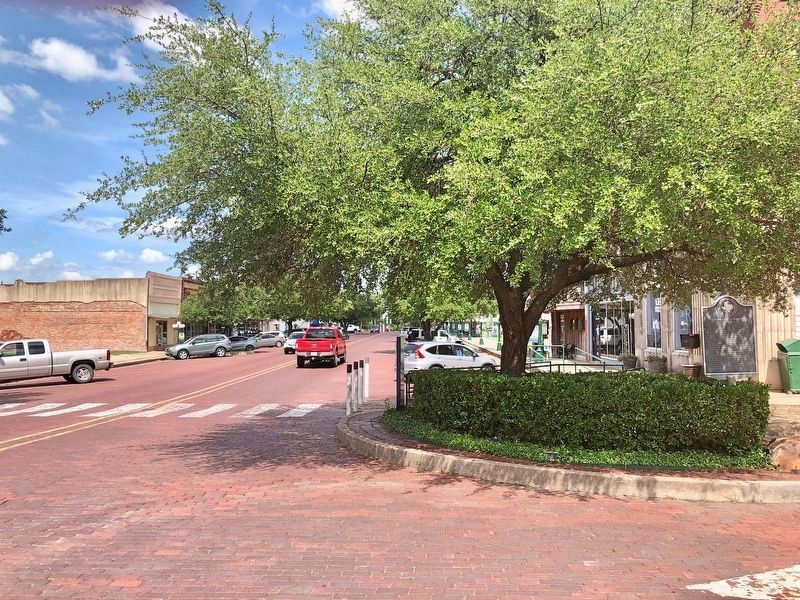 Incorporation of Commerce Marker on right of photo under tree. Main Street is on the left. image. Click for full size.