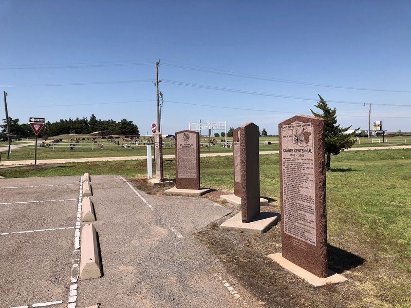 Canute Centennial Marker is in forefront with the Holy Family Cemetery in far background. image. Click for full size.