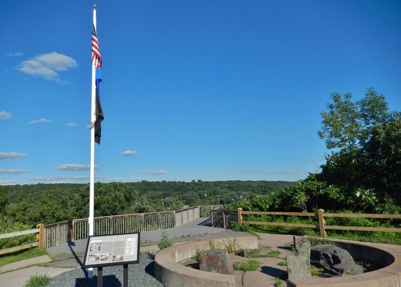 Saint Croix Falls Hydroelectric Project Marker (<i>wide view; marker visible right of flag pole</i>) image. Click for full size.