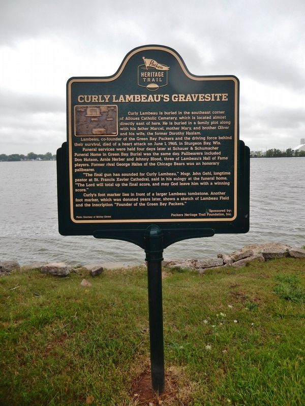 Curly Lambeau&#39;s Gravesite Marker (<i>tall view from Fox River Trail; Rox River in background</i>) image. Click for full size.