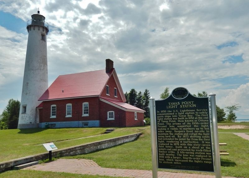 Tawas Point Light Station Marker (<i>side 1; wide view looking east; lighthouse in background</i>) image. Click for full size.