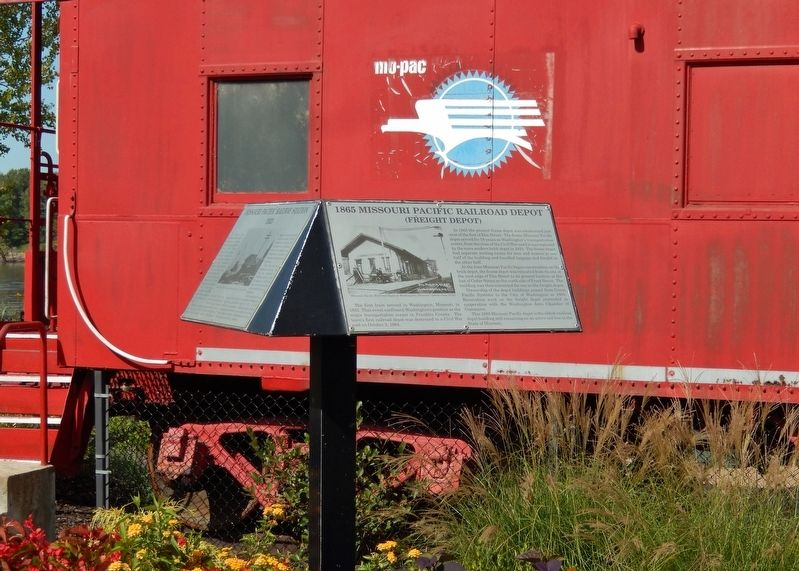 1856 Missouri Pacific Railroad Depot Marker (<i>tall view; MO-PAC caboose in background</i>) image. Click for full size.