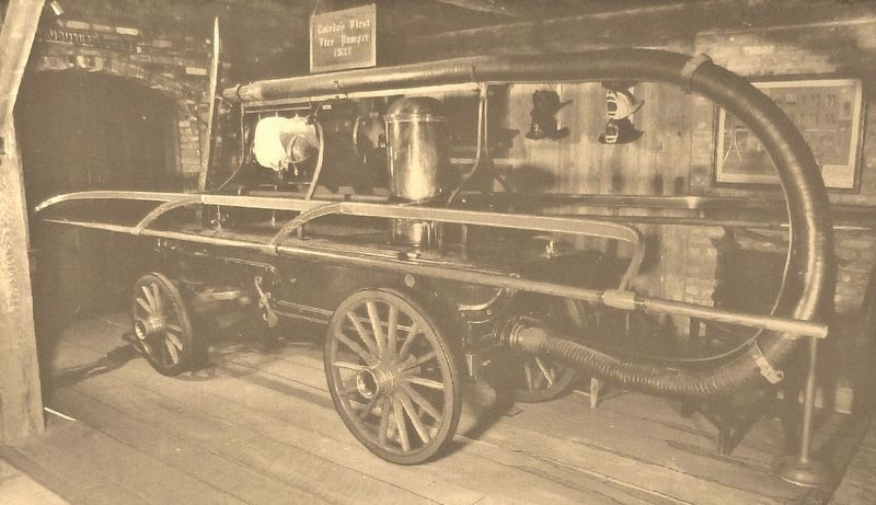 Marker detail: Toledo's first fire engine, 1837, hand pulled and hand pumped image. Click for full size.