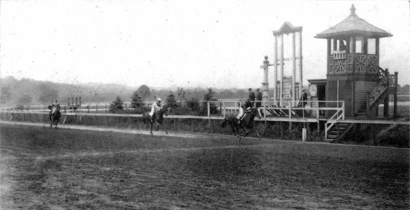 Jockeys Press Their Horses Across the Finish Line at Benning, 1913 image. Click for full size.