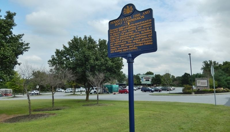 Pennsylvania Fish & Boat Commission Marker (<i>wide view; administration building in background</i>) image. Click for full size.