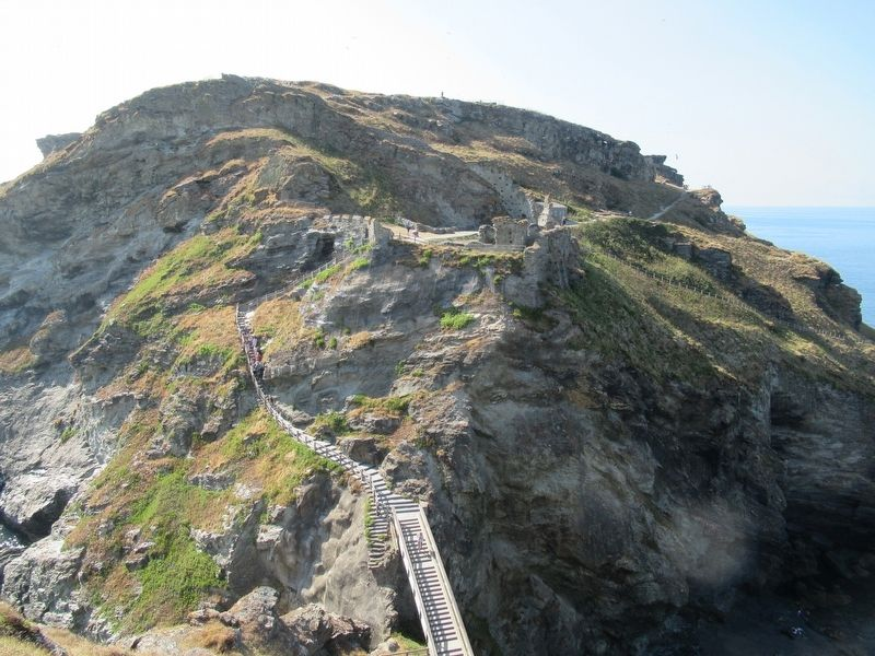 Over the bridge and up the steps to Tintagel Castle. image. Click for full size.