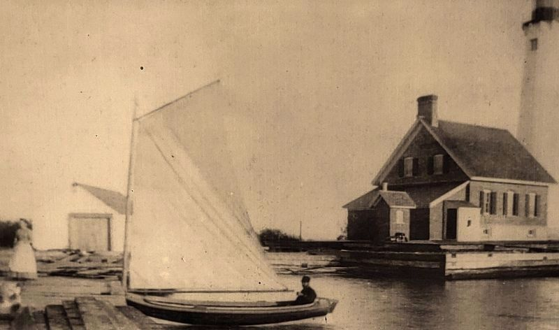 "Marker detail: This 1880s photo shows water surrounding the wooden ""crib"" protecting the lighthouse image. Click for full size."
