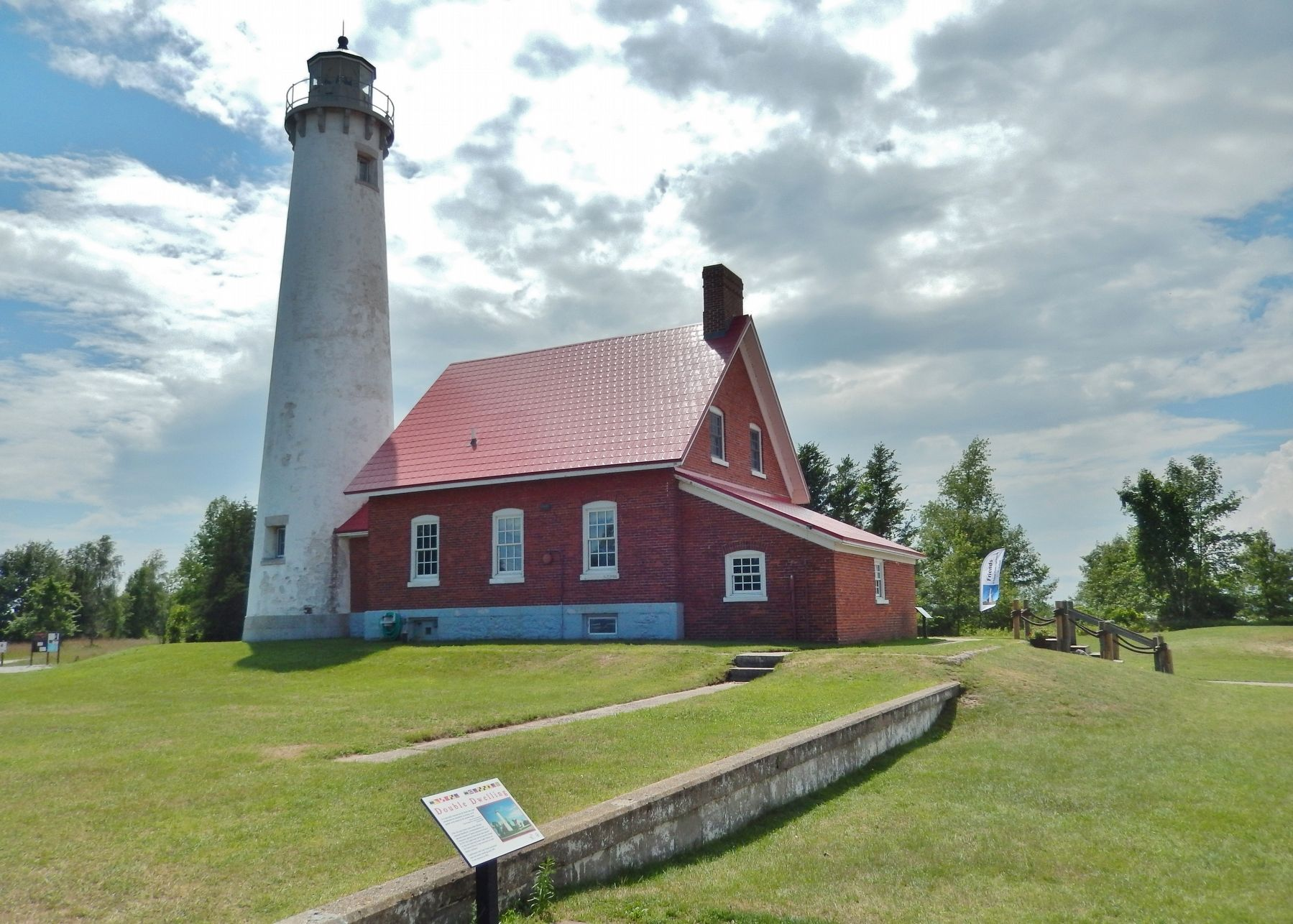 Double Dwelling Marker (<i>wide view; Tawas Point Light Station in background</i>) image. Click for full size.