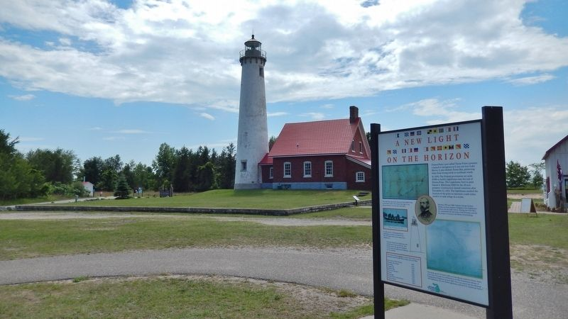 A New Light on the Horizon Marker (<i>wide view; Tawas Lighthouse in background</i>) image. Click for full size.