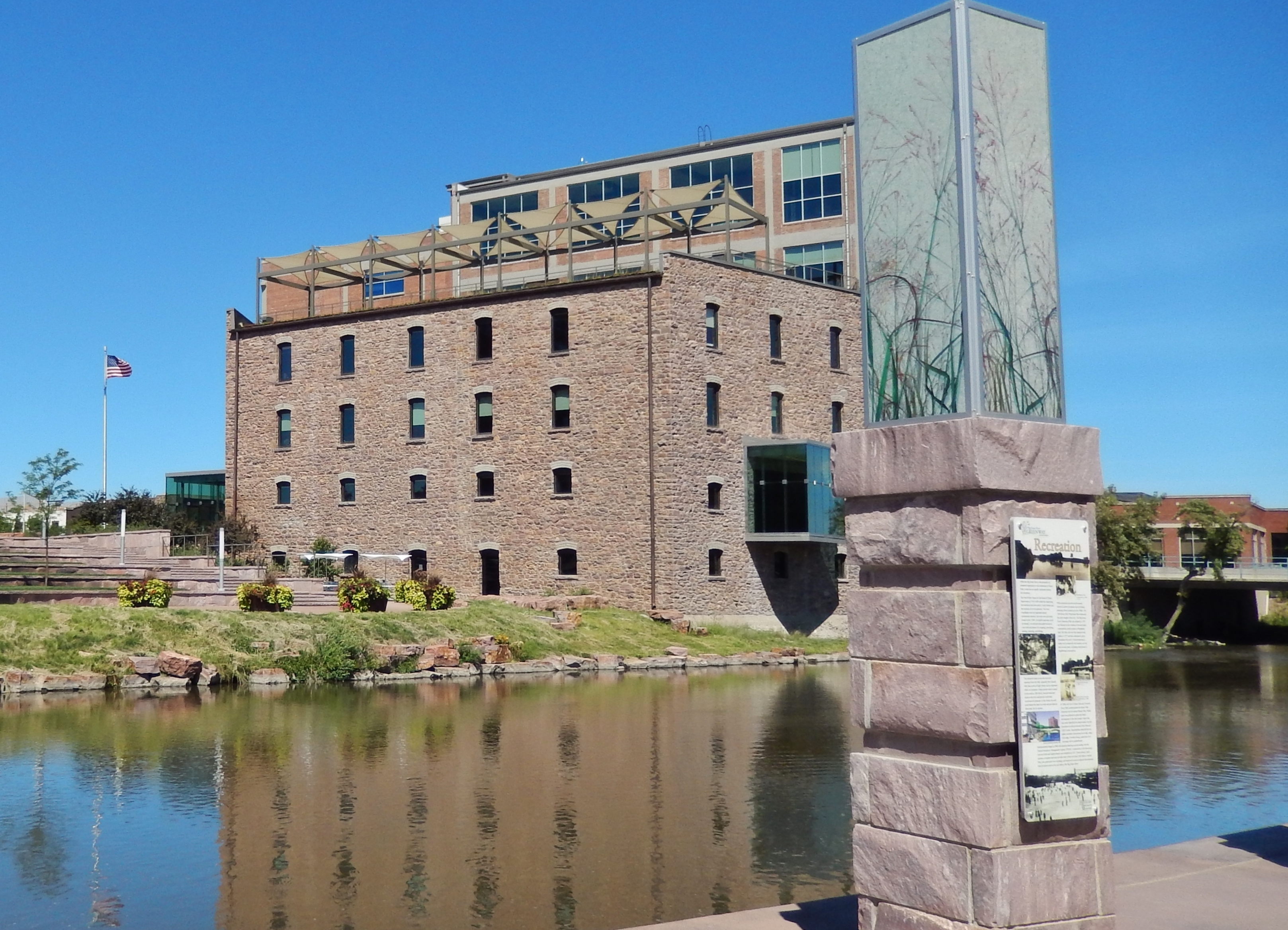 Recreation Marker (<i>wide view; Big Sioux River and Raven Industries building in background</i>)