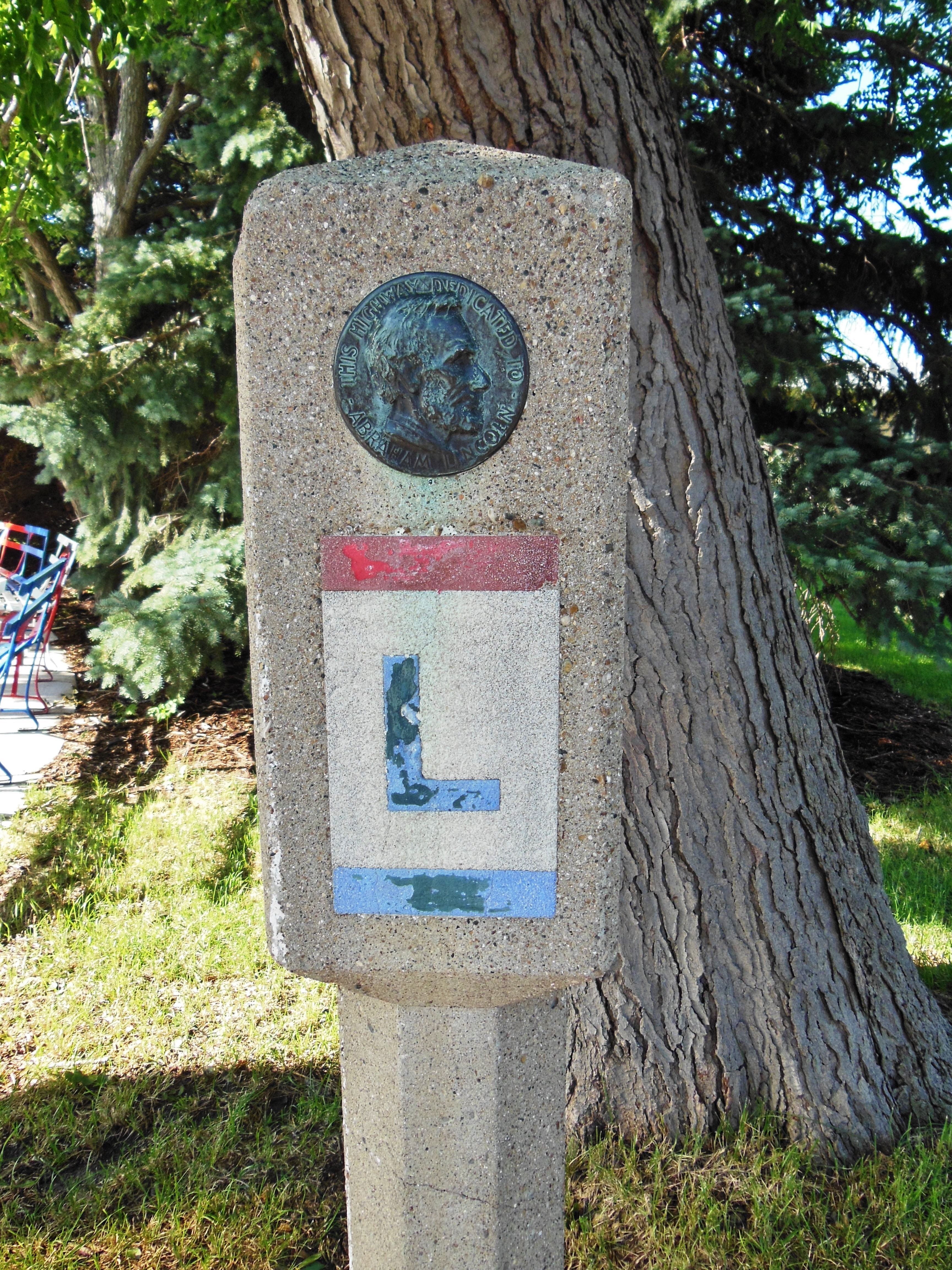 Old Lincoln Highway marker (<i>on Lincoln County Courthouse grounds</i>)