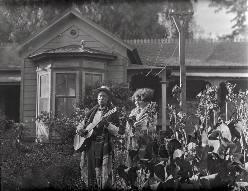 <i>Eugene R. Plummer and woman in shawl in front of Plummer House, Hollywood, 1927</i> image. Click for full size.