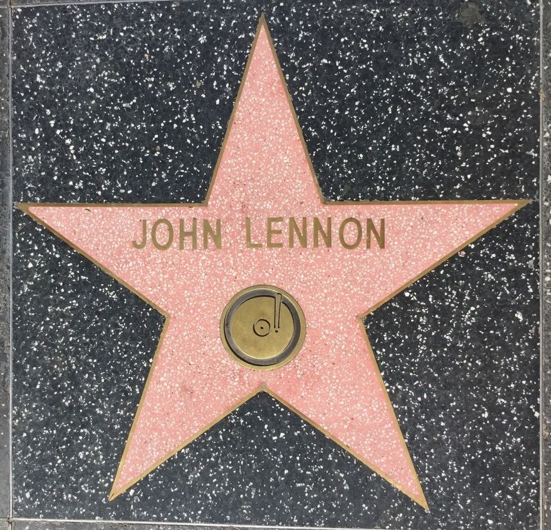 John Lennon's star in front of building image. Click for full size.