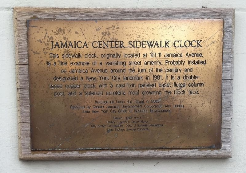 Jamaica Center Sidewalk Clock Marker image. Click for full size.
