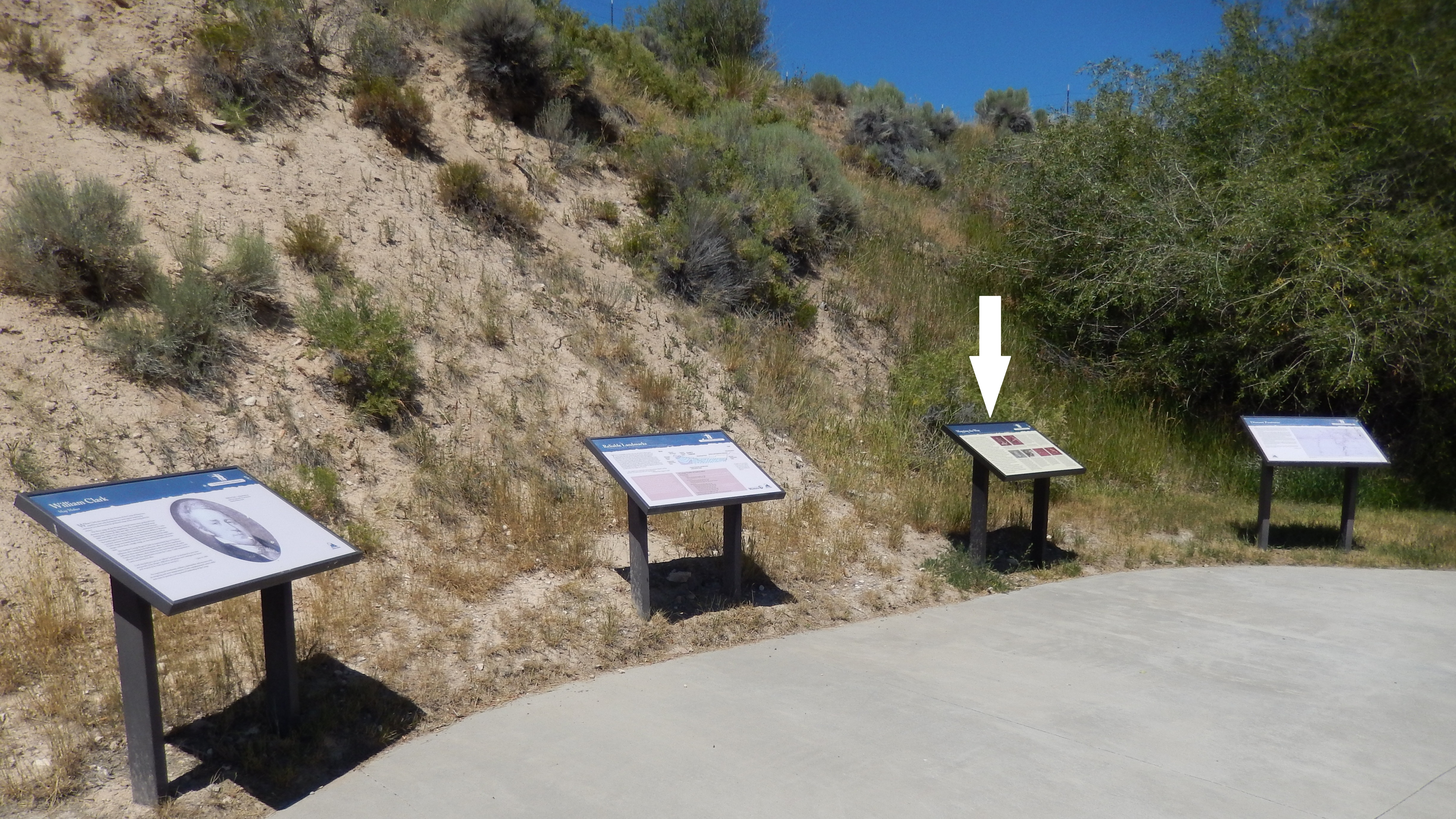 Mapping the Way Marker (<i>wide view showing related markers at trailhead</i>)