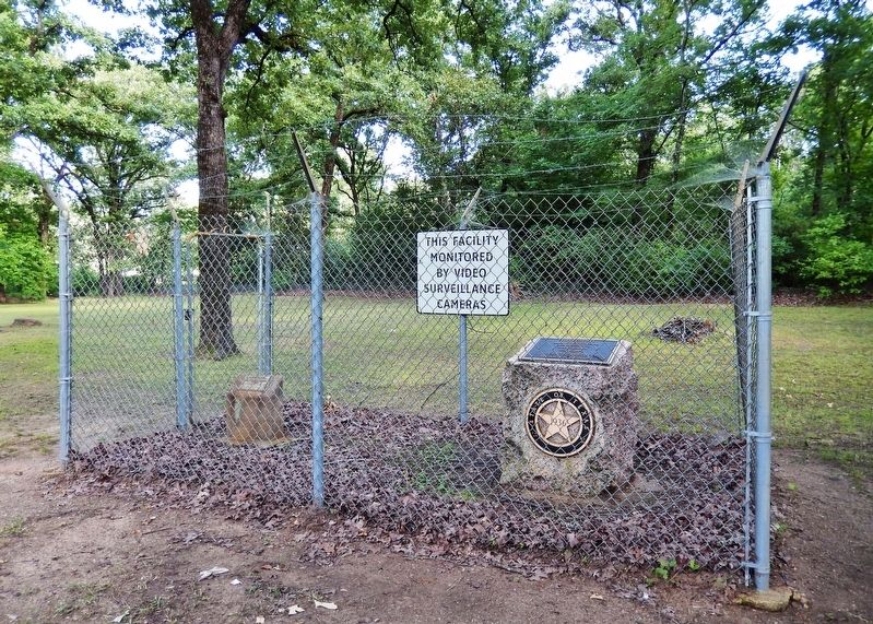 Titus County Marker (<i>wide view showing security fence surrounding marker</i>) image. Click for full size.