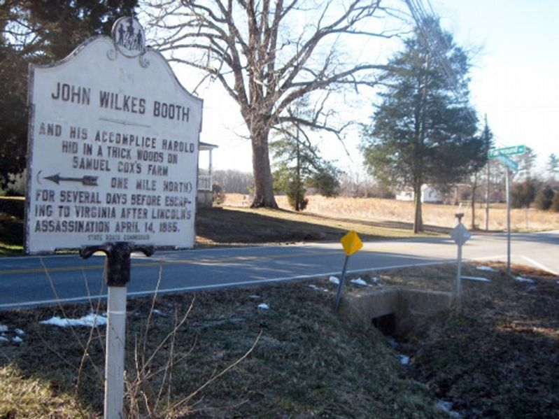 John Wilkes Booth Marker with intersection sign for Fairground Rd & Bel Alton Newtown Rd. image. Click for full size.