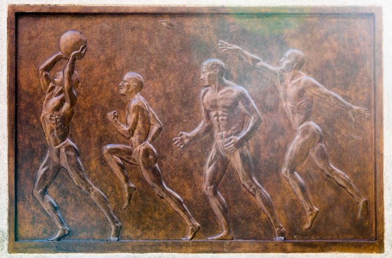 Bronze relief plaque on right of base image. Click for full size.