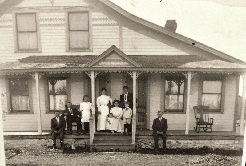 Marker detail: The August Johnson family in the first frame house in Ellison Bay image. Click for full size.
