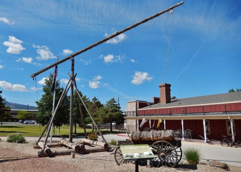 The Hay Derrick Marker (<i>wide view; hay derrick in background; museum to right</i>) image. Click for full size.