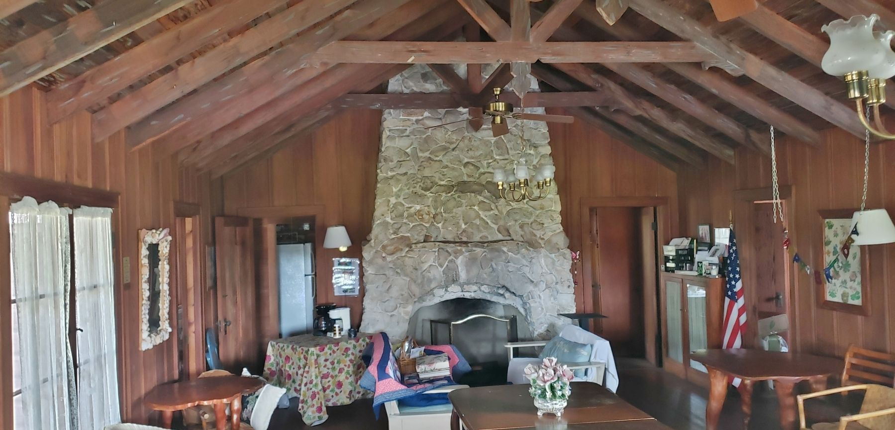 Garden Center Interior (<i>stone fireplace; cypress furniture, walls and rafters</i>) image. Click for full size.