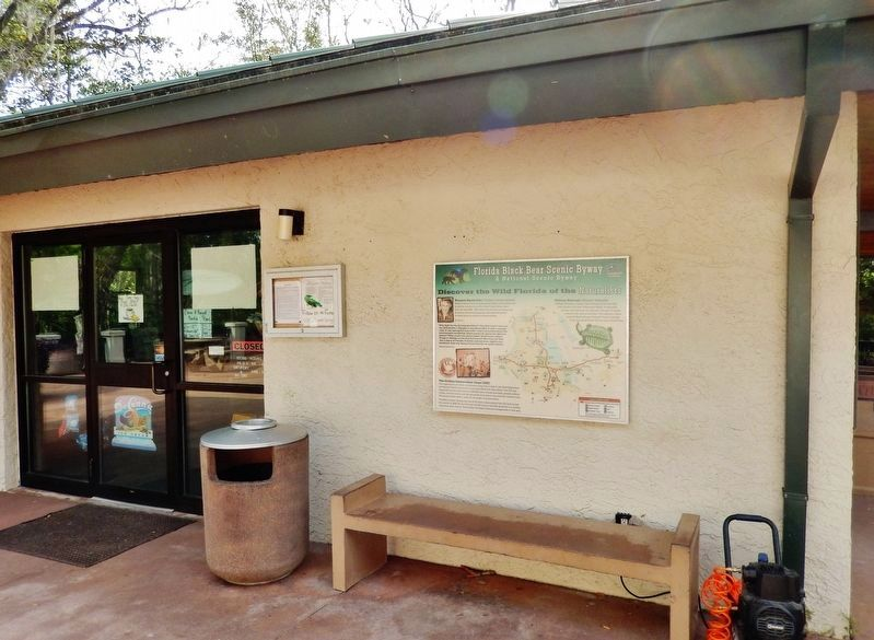 Florida Black Bear Scenic Byway Marker<br>(<i>wide view; marker mounted visitor center wall</i>) image. Click for full size.