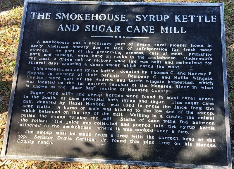 The Smokehouse, Syrup Kettle and Sugar Cane Mill Marker image. Click for full size.