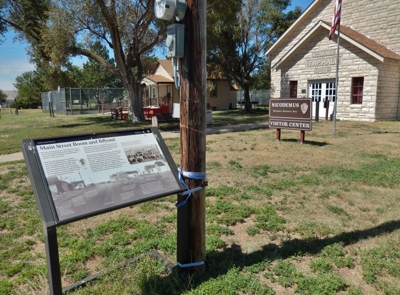 Main Street Boom and Beyond Marker (<i>wide view; Nicodemus NHS Visitor Center in background</i>) image. Click for full size.