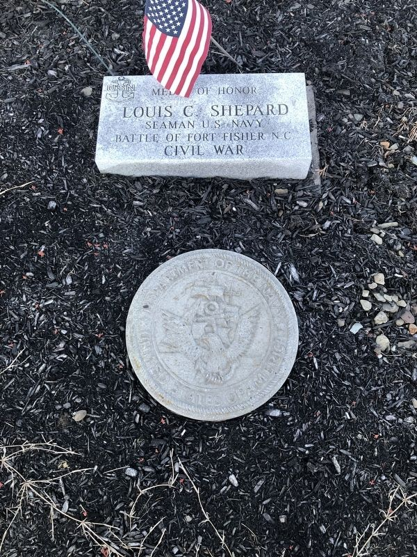 Plaque in front of the memorial image. Click for full size.