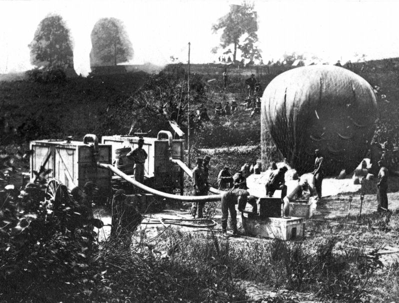 Professor Lowe inflating the balloon Intrepid to reconnoiter the Battle of Fair Oaks image. Click for full size.