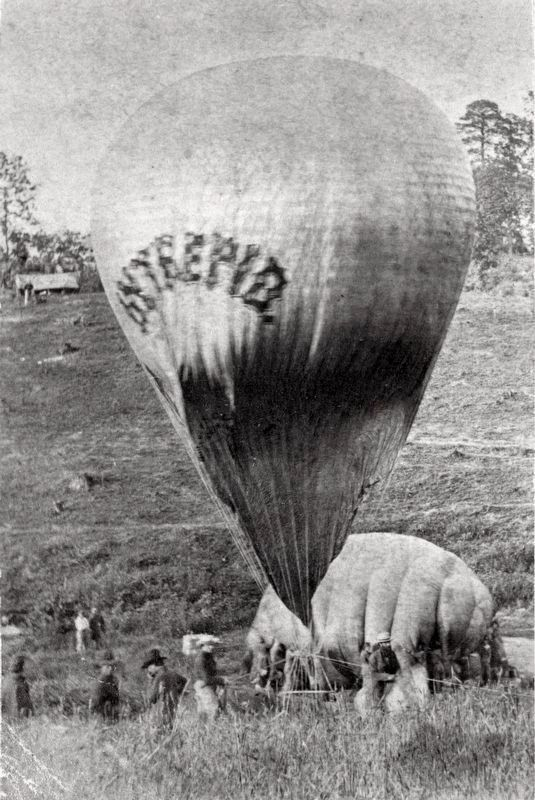 Professor Lowe inflating the balloon <i>Intrepid</i> from gas in balloon <i>Constitution</i> image. Click for full size.
