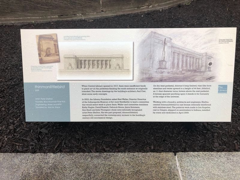 Nearby plaque describing <i>thinmanlittlebird</i> on the grounds of the library image. Click for full size.
