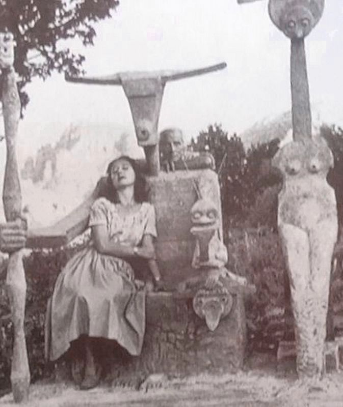 Max Ernst and his wife Dorothea, with his most famous sculpture - Capricorn. image. Click for full size.