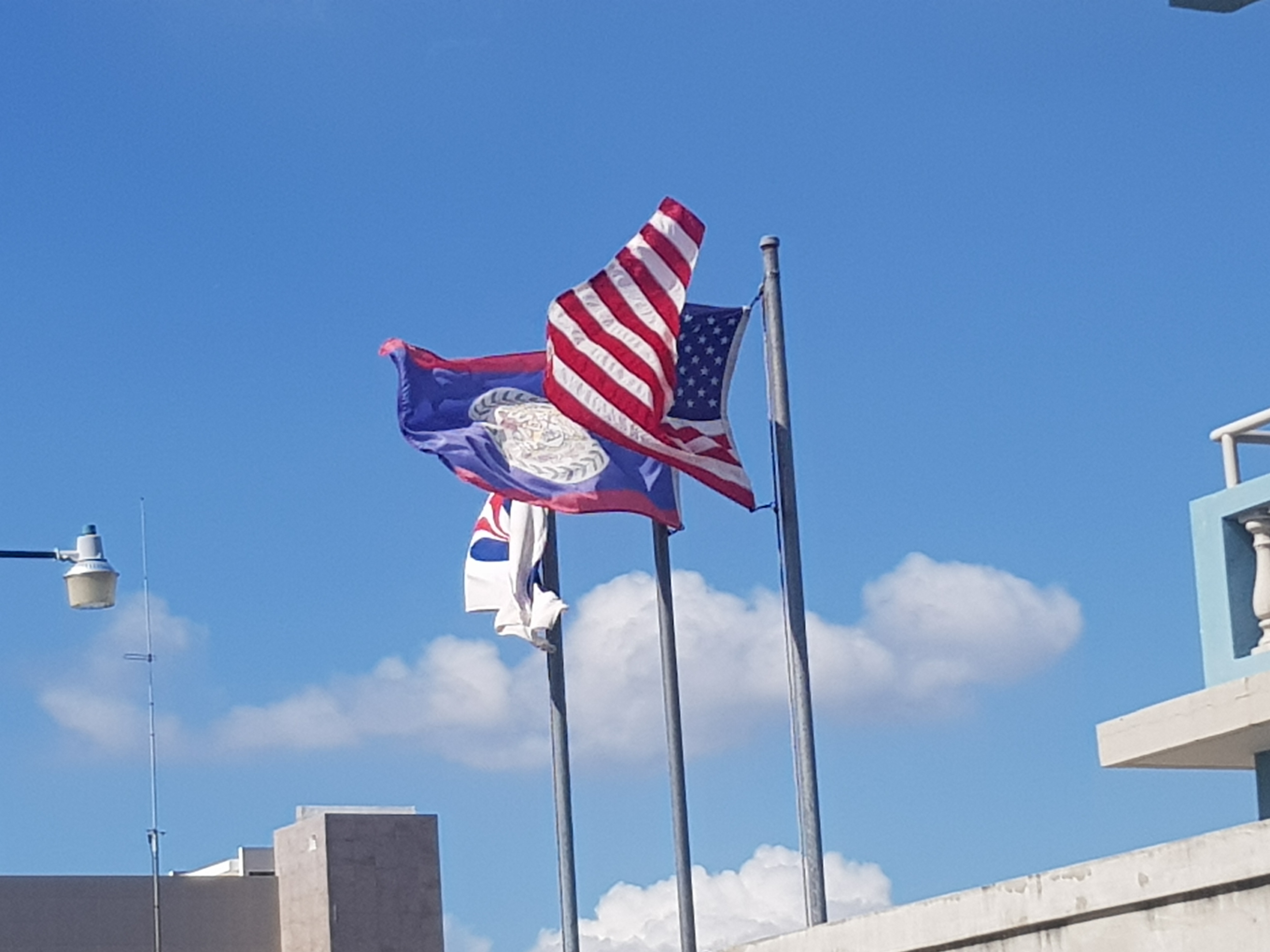 The flags of Belize and the United States of America flying at the nearby Peace Corps office