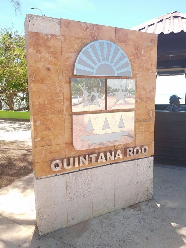 "A Quintana Roo State Seal monument, near the ""Aquí Inicia México"" letters on the Boulevard Bahía image. Click for full size."