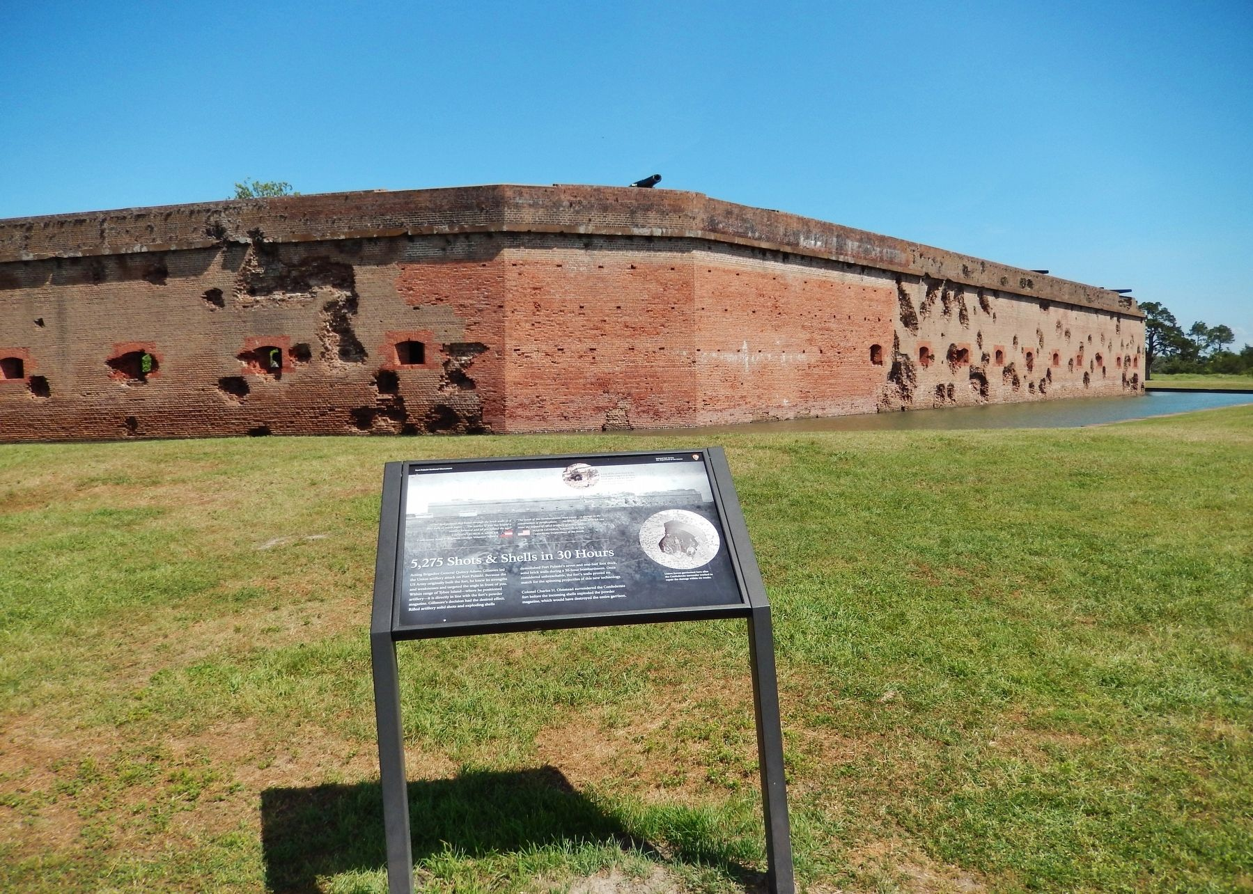 5,275 Shots & Shells Marker (<i>wide view • damaged south & east walls in background</i>) image. Click for full size.