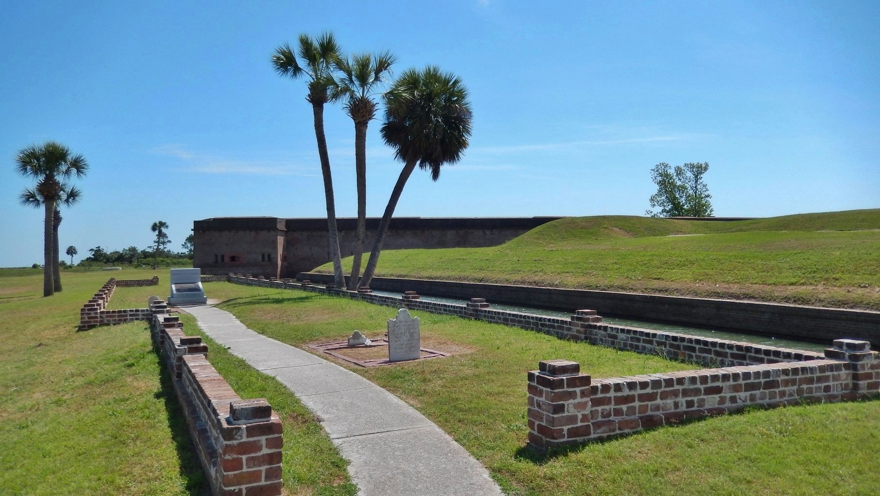 Fort Pulaski Cemetery (<i>view from near marker • Fort Pulaski in background</i>) image. Click for full size.