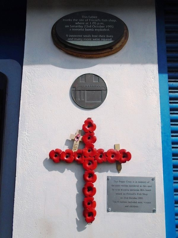 Frizzell's Fish Shop Bombing Victims Markers and Poppy Cross image. Click for full size.