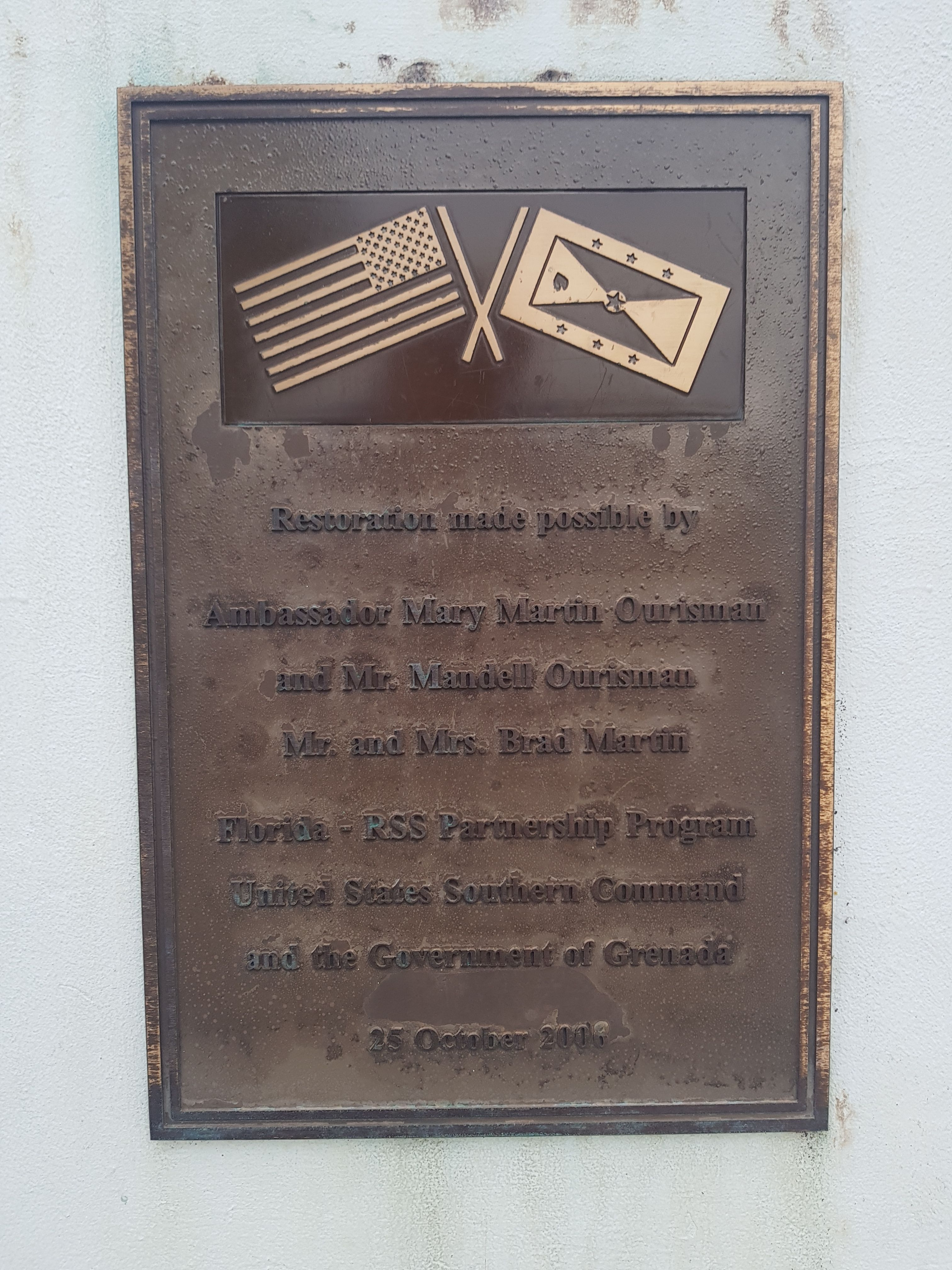 A restoration plaque on the Memorial to the Fallen in Grenada