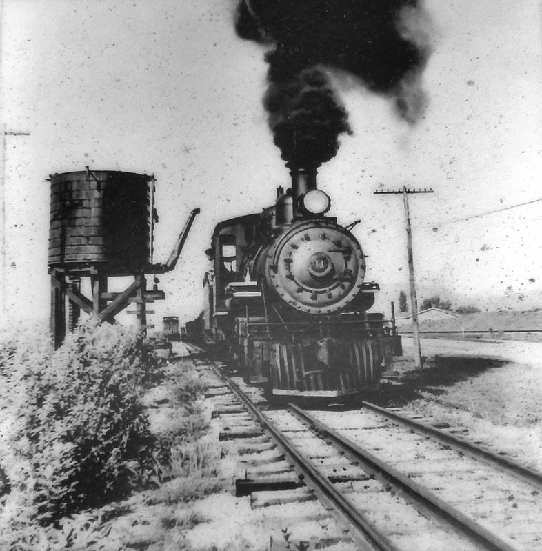 Marker detail: Locomotive passes the water tower that was located just east of Bemberg Station image. Click for full size.