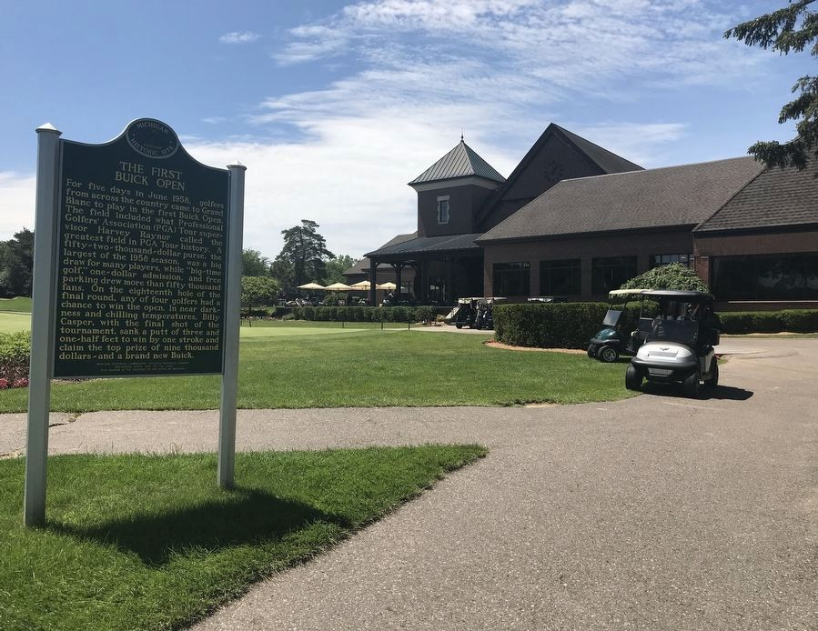 View of the Marker and the back of the clubhouse. image. Click for full size.